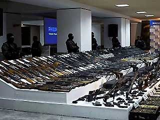 Soldiers stand guard around a presentation of arms captured in arrest of Jaime Gonzalez Duran, alias 'El Hummer' in Mexico City in November, 2008.