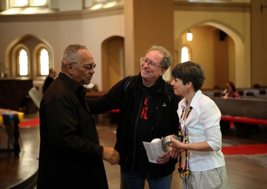 Rev. Dr. Jeremiah Wright and Dr. William Ayers are greeted by Rebekah Levin with the Committee for a Just Peace in Israel and Palestine. (Chuck Berman/Chicago Tribune / May 17, 2009)
