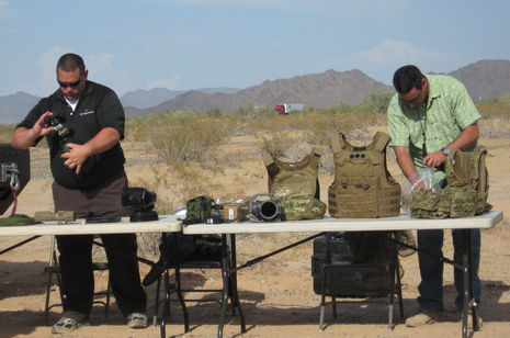 Deputies prepare equipment for Joe Arpaio's crime sweep in the Southwestern corner of Marciopa County.  Photo by: Laurie Merrill / the Arizona Republic.