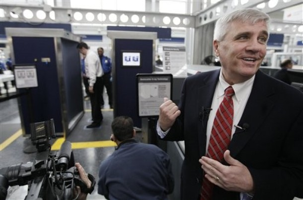 Eddie Mayenschein, Transportation Security Administration, Office of Security, General Manager, narrates procedures as volunteers go through the first full body scanner installed at O'Hare International Airport , Monday, March 15, 2010, in Chicago. Federal transportation authorities demonstrated the technology to the media before starting to send passengers through the machine later today. Officials say they don't expect the body scanner which takes seconds to pass through to slow down security lines. (AP Photo/M. Spencer Green)