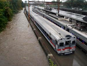 Two Southeastern Pennsylvania Transportation Authority trains sit in water on flooded tracks at Trenton train station in Trenton, N.J.  AP
