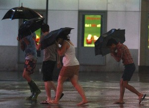Tourists walk through Times Square as Hurricane Irene arrives in New York. Photo: Reuters