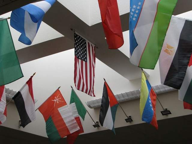 Bauder Elementary School, which has more than 60 international students, has a flag display that features the U.S. flag above the flags of the home nations of its students. / Photo courtesy Poudre School District