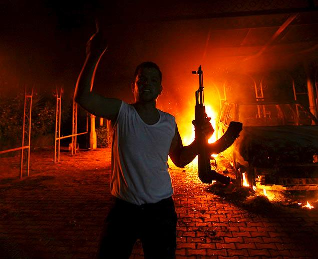 OBAMA BUILT THIS -- A protester reacts as the U.S. Consulate in Benghazi is seen in flames during a protest by an armed group said to have been protesting a film being produced in the United States September 11, 2012.  Image courtesy of NYDN.