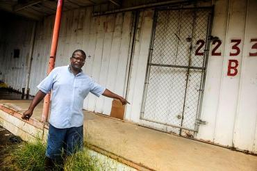 Steven Cherry at a loading dock where he and his wife Belinda Cherry slept when they were homeless.  Image courtesy of JAMES KEIVOM/NEW YORK DAILY NEWS.