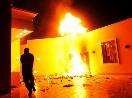 The U.S. Consulate in Benghazi is seen in flames during a protest by an armed group said to have been protesting a film being produced in the United States September 11, 2012.  Image courtesy of Esam Al-Fetori/NYDN.