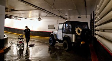 The Toyota Land Cruiser in which Anthony Narh, an immigrant from Ghana, futilely sought refuge as the Empire Parking garage was inundated during the storm.  Image courtesy of Marcus Yam for The New York Times.