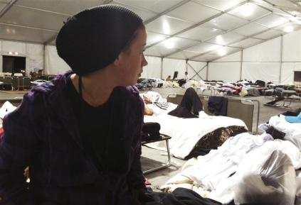 Ashley Sabol, 21, of Seaside Heights, New Jersey looks over her accommodations at Tent City in Monmouth Park in Oceanport