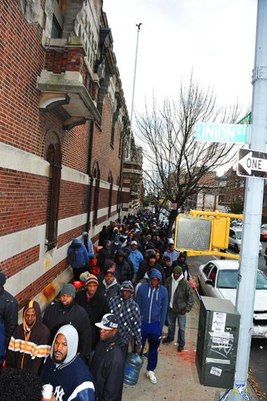 Thousands of people lined up in hopes to receive 11,000 gallons of free gas being distributed by the military at the Bedford Avenue Armory in Crown Heights, Brooklyn on November 3, 2012.  Image courtesy of Todd Maisel/New York Daily News.