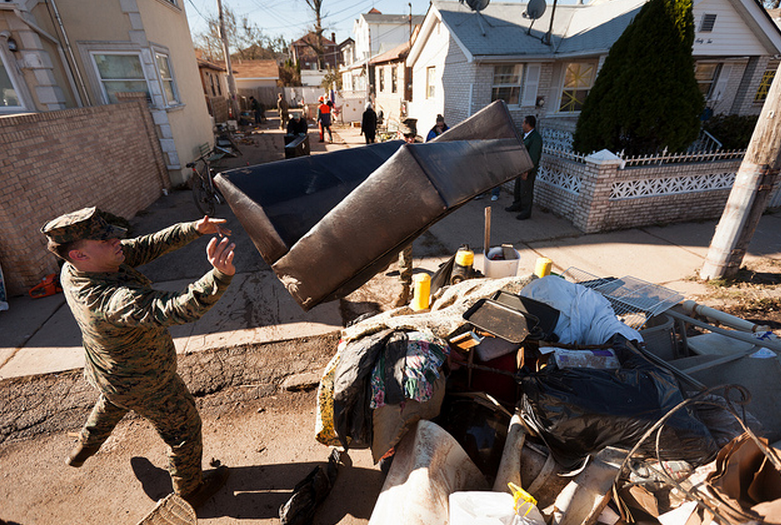Picking Up After Sandy  Corporal Thomas Cavallo, an airframe mechanic with Marine Heavy Helicopter Squadron 366, and Lance Cpl. Corey Shaw, a cook with the 26th Marine Expeditionary Unit, throw a couch on the street in Staten Island, N.Y., Nov. 4. The 26th MEU is able to provide generators, fuel, clean water, and helicopter lift capabilities to aid in disaster relief efforts. The 26th MEU is currently conducting pre-deployment training, preparing for their departure in 2013. As an expeditionary crisis response force operating from the sea, the MEU is a Marine Air-Ground Task Force capable of conducting amphibious operations, crisis response, and limited contingency operations.  (U.S. Marine Corps photo by Cpl. Bryan Nygaard)