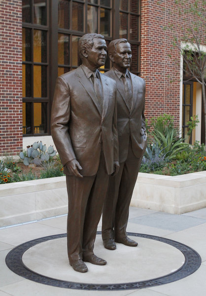 Bronze statues of former United States Presidents George W. Bush and his father George H.W. Bush are in the courtyard of the George W. Bush Presidential Center.  Image courtesy of Paul Moseley/Star-Telegram.