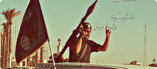 """""""The original cover photo on Facebook page of the February 17th Martyrs Brigade, displaying the al-Qaida banner.  An Arabic inscription written over the photo reads: """"Allah, his prophet and Libya and that's it.""""  The cover photo was posted by the site administrator on June 10, 2012 and was the first activity on the Facebook page.""""  Source:  ConservativeRead."""
