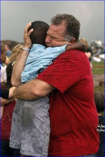 A teachers hugs a child at Briarwood Elementary school after a tornado destroyed the school in south OKC Oklahoma City, OK, Monday, May 20, 2013. Near SW 149th and Hudson. By Paul Hellstern, The Oklahoman