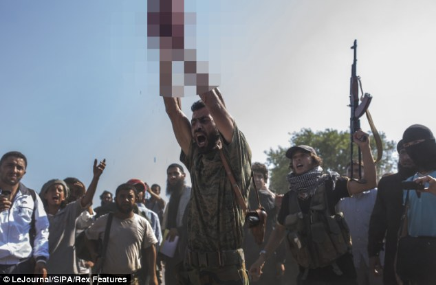 Al Nusrah Syrian Rebels behead Christian male Maloula