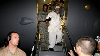 Ibrahim Othman Ibrahim Idris escorted off plane by US Military for release to Sudanese government, Khartoum.