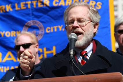 New York State assemblyman Richard Gottfried speaks during the USPS employee rally in eight Avenue & 31st street on March 24,2013.