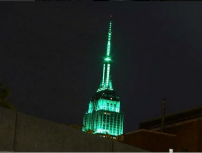 screenshot empire state building tower lights go green for EID