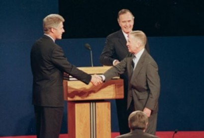 Perot didn't make an impressive figure standing between two men who stood a full head taller than him