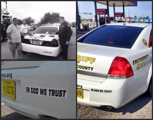 "Walton County Sheriff's Department vehicles with bumper sticker ""In God We Trust"" (Facebook)."
