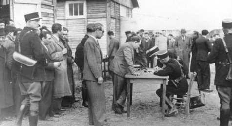 French police register prisoners at Pithiviers camp World War II - wikimedia commons