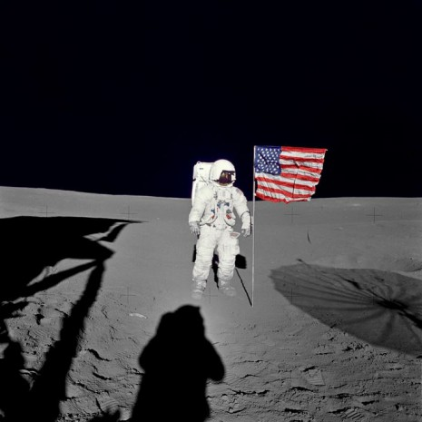 "Astronaut Edgar D. Mitchell, Apollo 14 lunar module pilot stands by the deployed U.S. flag on the lunar surface during the early moments of the mission's first spacewalk. He was photographed by astronaut Alan B. Shepard Jr., mission commander. While astronauts Shepard and Mitchell descended in the Lunar Module ""Antares"" to explore the Fra Mauro region of the moon, astronaut Stuart A. Roosa, command module pilot, remained with the Command and Service Module ""Kitty Hawk"" in lunar orbit. Credit: NASA.gov"