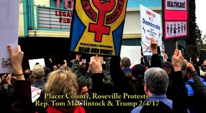 screenshot-anti-trump-protests-at-townhalls-465-x-258