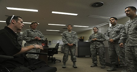 "<span style=""font-size: 8pt;"">Bryan Anderson, U.S. Army veteran and triple amputee, talks with members from the 18th Security Forces Squadron on Kadena Air Base, Japan, June 17, 2013. Anderson was a military policeman in the Army and was able to see how U.S. Air Force security forces members conduct their mission within the different sections of their squadron. (U.S. Air Force photo by Airman 1st Class Malia Jenkins/Released)</span>"