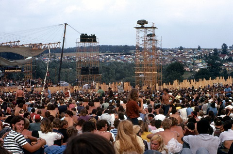 "<span style=""font-size: 8pt; font-family: arial, helvetica, sans-serif;"">Woodstock Music and Art Fair. The person carrying the placard is Moonfire Lewis Beach Marvin III. Joe Cocker is performing on stage.  (August 17, 1969) Source: Woodstock Whisperer, <a href=""https://commons.wikimedia.org/wiki/File:Woodstock_Music_and_Art_Fair.jpg"">Wikimedia Commons</a> (<a href=""https://creativecommons.org/licenses/by-sa/4.0/deed.en"">CC BY-SA 4.0</a>)</span>"